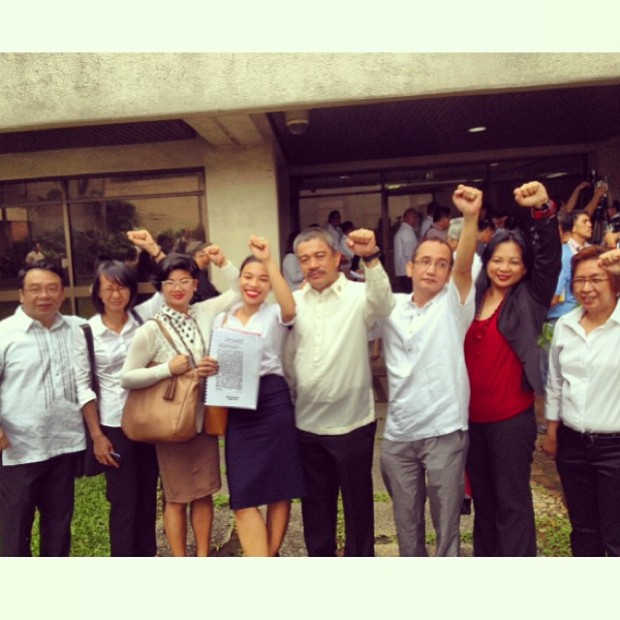 2014: NYCHRP member Jackie standing with Bayan Muna partylist representatives Congressman Neri Colmenares and Congressman Carlos Zarate, and National Union of Peoples' Lawyers (NUPL) legal team, holding the official impeachment complaint filed against President Benigno Aquino III for culpable violation of the constitution and betrayal of public trust.